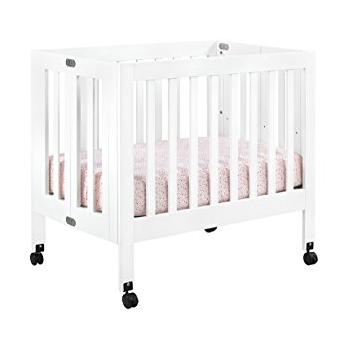 rolling mini crib